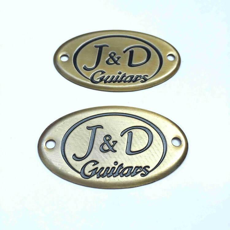 Etched metal logo plates
