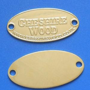 Oval metal logo plate
