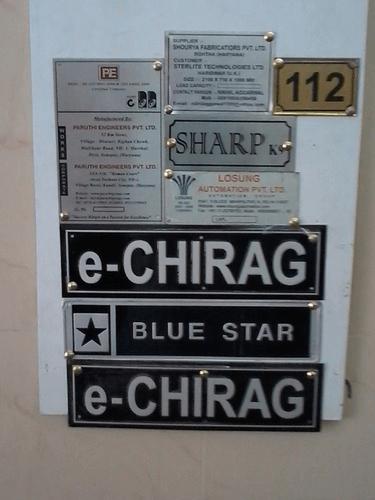 Metal nameplate for industrial machines